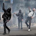 """Prognose voor 2020: Sociale onrust en volksopstanden zullen """"exploderen"""""""